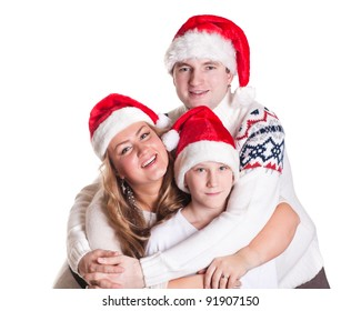 Happy family in Santa Claus caps on a white background.