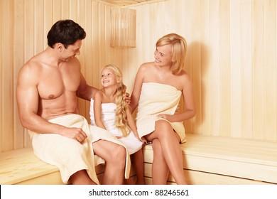 Happy family in the sauna