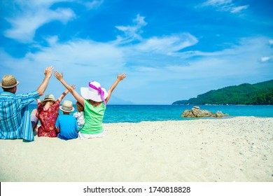happy family at sea in greece on nature background