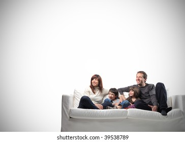 happy family seated on a couch with copy space