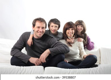 happy family seated on a sofa