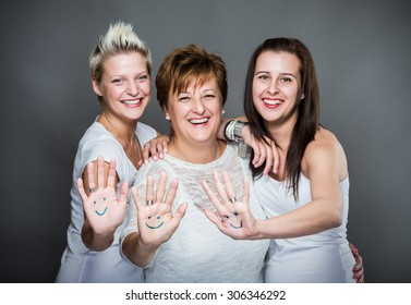 Happy family show their smiley-draw hands.