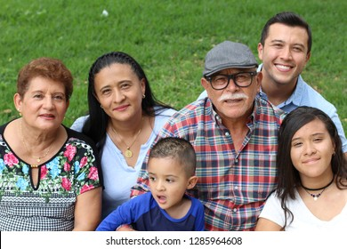 Happy family of six Latinos