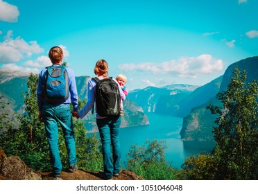 happy family with small baby travel in Norway