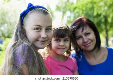 Happy family with smiling girl in front while summer time