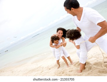 happy family smiling and having fun outdoors pulling a rope