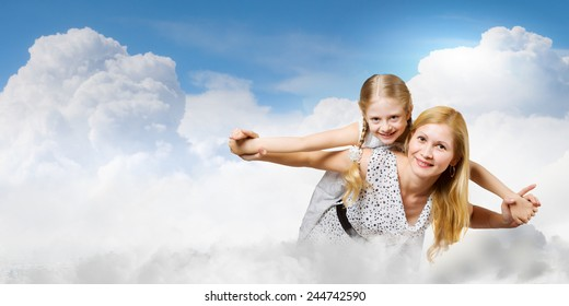 Happy family of smiling mother and daughter