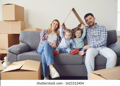Happy family smiling at a new house moving.