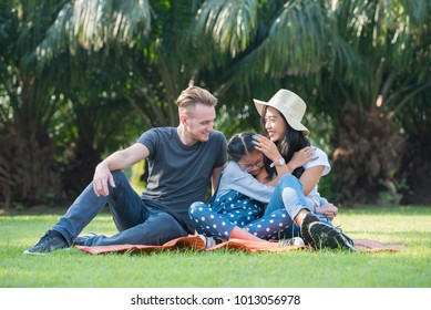 Happy family spend time together, sitting or lying on green grass, family concept.