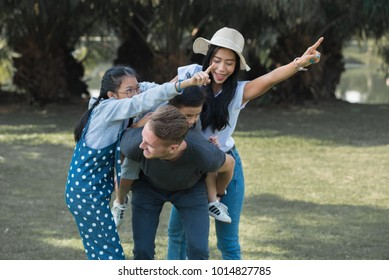 Happy family spend time together in the park, family concept.