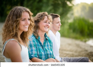 Happy family spending time outdoor on a summer day
