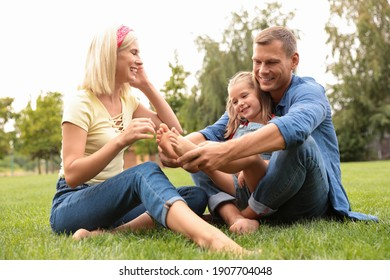 Happy family spending time together in park on sunny summer day