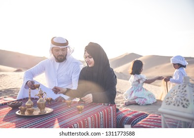 Happy family spending a wonderful day in the desert making a picnic