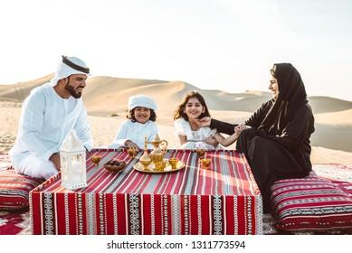 Happy family spending a wonderful day in the desert