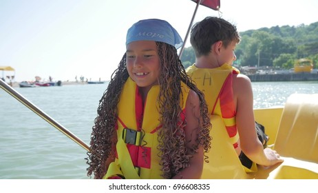 Happy family is swimming on a catamaran on the sea to the ocean. family holiday