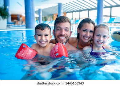 Happy family in the swimming pool, concept of family time