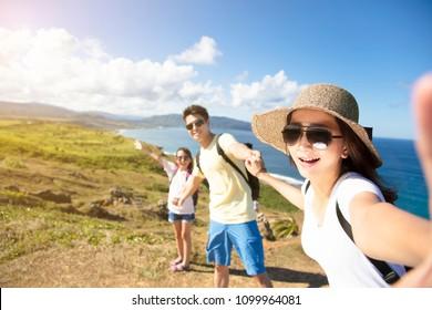 happy family taking selfie on the coast