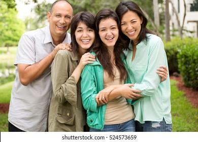 Happy family with teenage children.