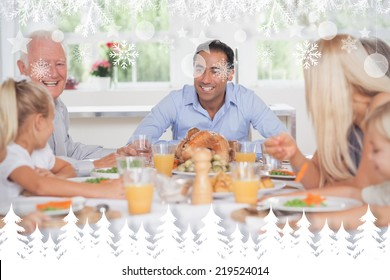 Happy family at thanksgiving against fir tree forest and snowflakes