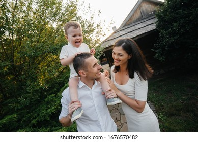 Happy family with their son walking in the Park at sunset. Happiness. Love