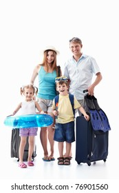A happy family with their suitcases on a white background