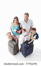 A happy family with their suitcases and passports to leave on a white background