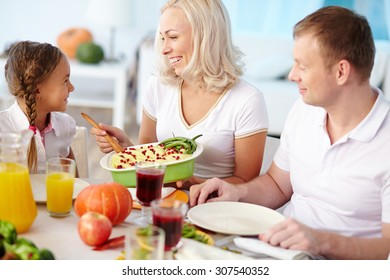 Happy family of three dining together