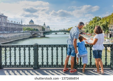 Happy family of three enjoying their vacation in Paris, France