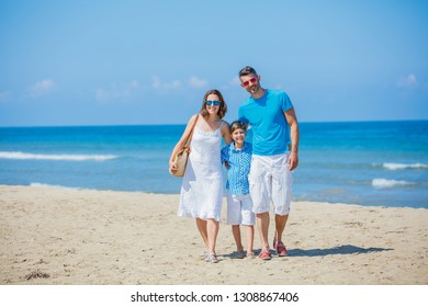 Happy family of three having fun in the summer leisure