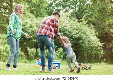 Happy family of three having fun in the park.