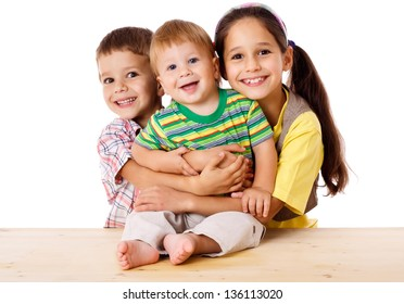 Happy family with three kids hugging together, isolated on white