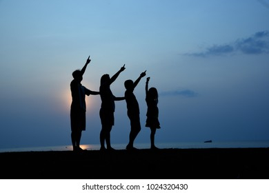 Happy family time, Silhouette people activity at sun set.