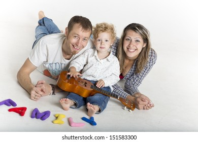 Happy family with a toddler on the floor