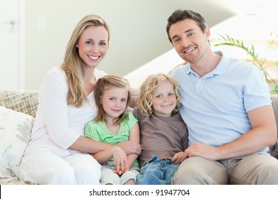 Happy family together on the couch