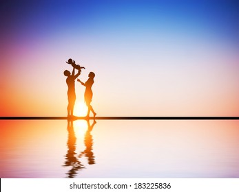 Happy family together, parents celebrating their little child at romantic sunset. Birth, mother, father concepts