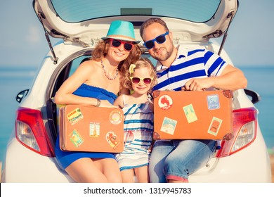 Happy family travel by car. People having fun on the beach. Summer vacation concept