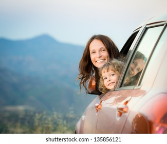 Happy family travel by car in the mountains. Summer vacation concept