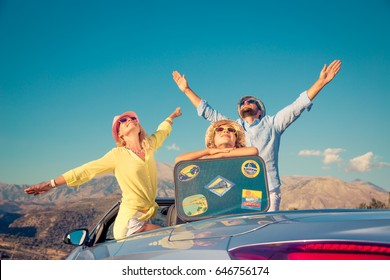 Happy family travel by car. People having fun in the mountains. Father, mother and child on summer vacation.
