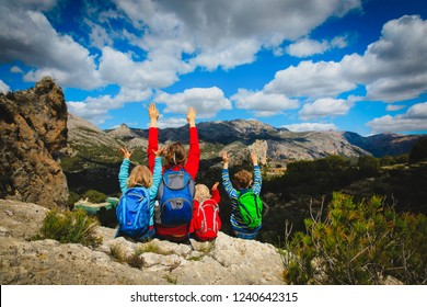 happy family travel hiking in mountains,Guadalest, Alicante, Spain