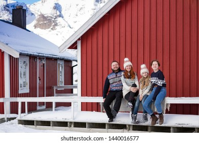 happy family trip to lofoten islands. dad, mom and two daughters  fun posing for the camera. Norway