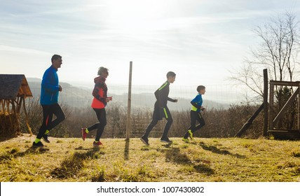 Happy Family with two boys running or jogging for sport