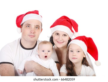 Happy family with two children in Christmas red caps