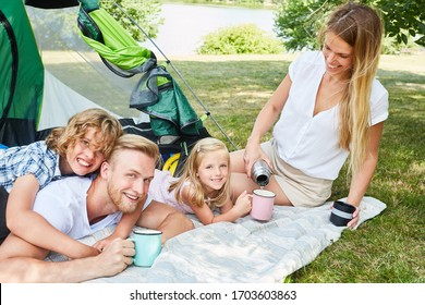 Happy family with two kids camping in nature in summer vacation