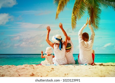 happy family with two kids have fun on beach