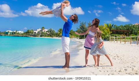 Happy family with two kids on summer vacation