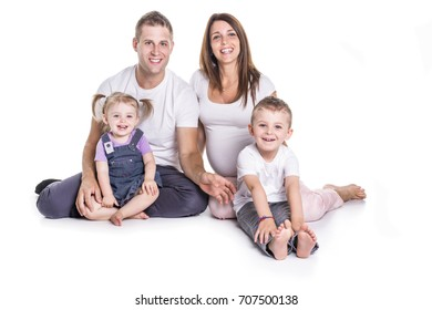 Happy family with two kids on studio white background