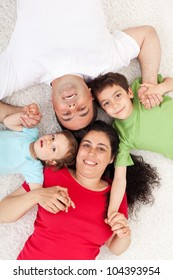 Happy family with two kids - portrait on the floor