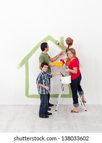 Happy family with two kids redecorating their new home together