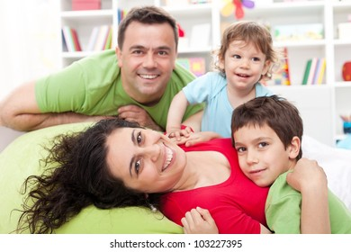 Happy family with two kids - together at home
