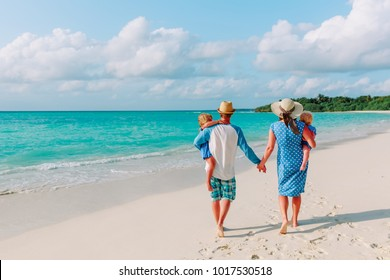 happy family with two kids walk on beach